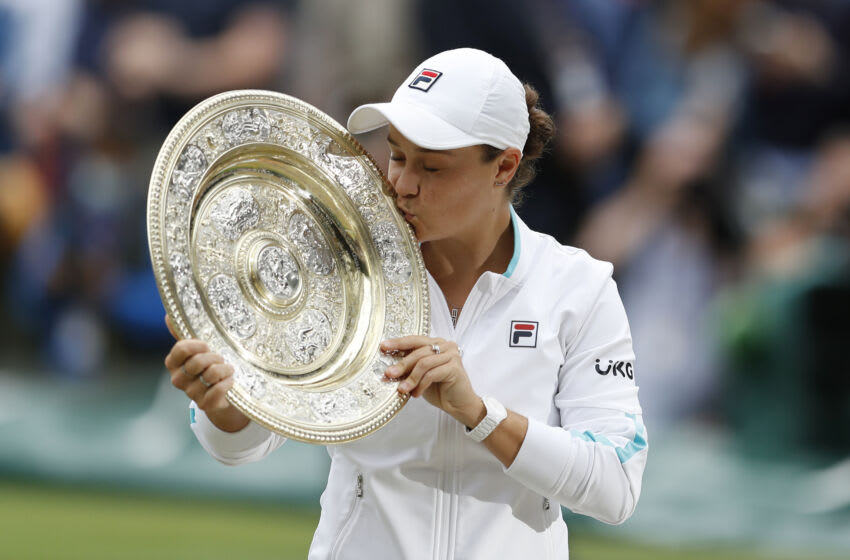 LONDON, ENGLAND - JULY 10: Ashleigh Barty of Australia celebrates with the Venus Rosewater Dish trophy after winning her Ladies' Singles Final match against Karolina Pliskova of The Czech Republic on Day Twelve of The Championships - Wimbledon 2021 at All England Lawn Tennis and Croquet Club on July 10, 2021 in London, England. (Photo by Peter Nicholls - Pool/Getty Images)
