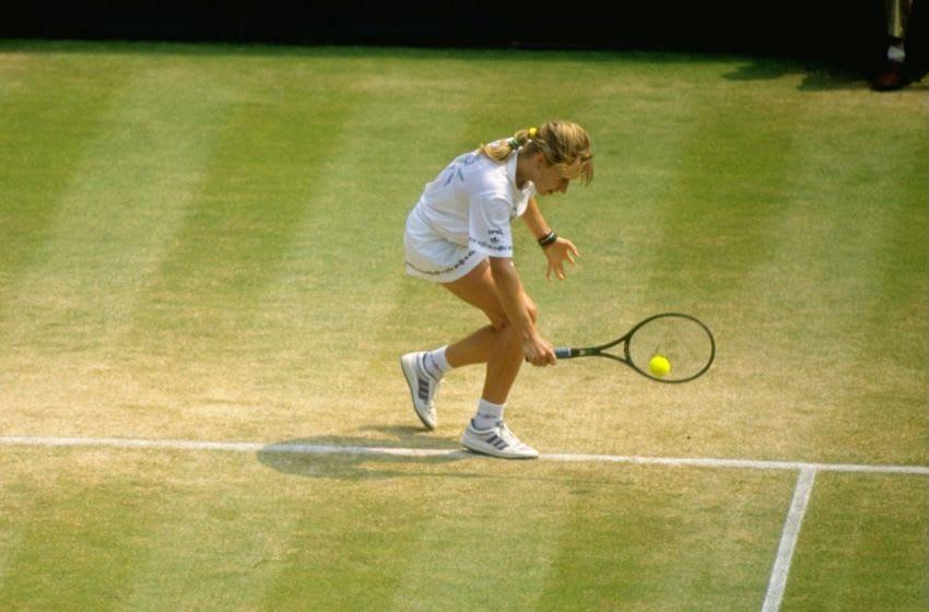 Jun-Jul 1989: Steffi Graf of West Germany plays a backhand return during the Lawn Tennis Championships at Wimbledon in London. \ Mandatory Credit: Allsport UK /Allsport