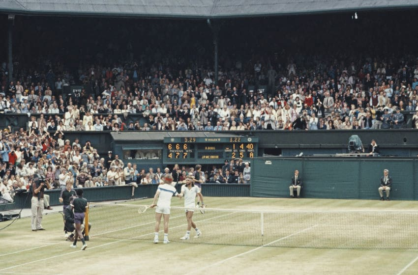 John McEnroe of the United States reaches over the net to shake hands with Bjorn Borg after defeating him during the Men's Singles Final match at the Wimbledon Lawn Tennis Championship on 4 July 1981 at the All England Lawn Tennis and Croquet Club in Wimbledon in London, England. (Photo by Tony Duffy/Allsport/Getty Images)