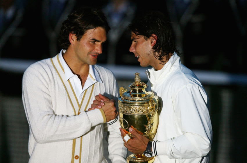 LONDON - JULY 06: Roger Federer of Switzerland congratulates Rafael Nadal of Spain in winning the Championship trophy during the men's singles Final on day thirteen of the Wimbledon Lawn Tennis Championships at the All England Lawn Tennis and Croquet Club on July 6, 2008 in London, England. (Photo by Julian Finney/Getty Images)