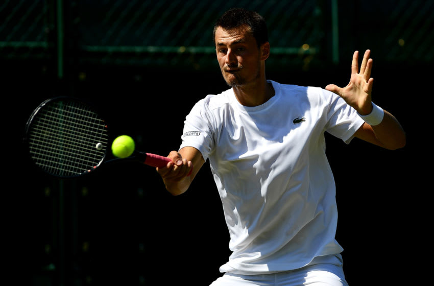 LONDON, ENGLAND - JUNE 25: Bernard Tomic of Australia in action against Matteo Donati of Italy during the Wimbledon Lawn Tennis Championships Qualifying at The Bank of England Sports Centre on June 25, 2018 in London, England. (Photo by Justin Setterfield/Getty Images)