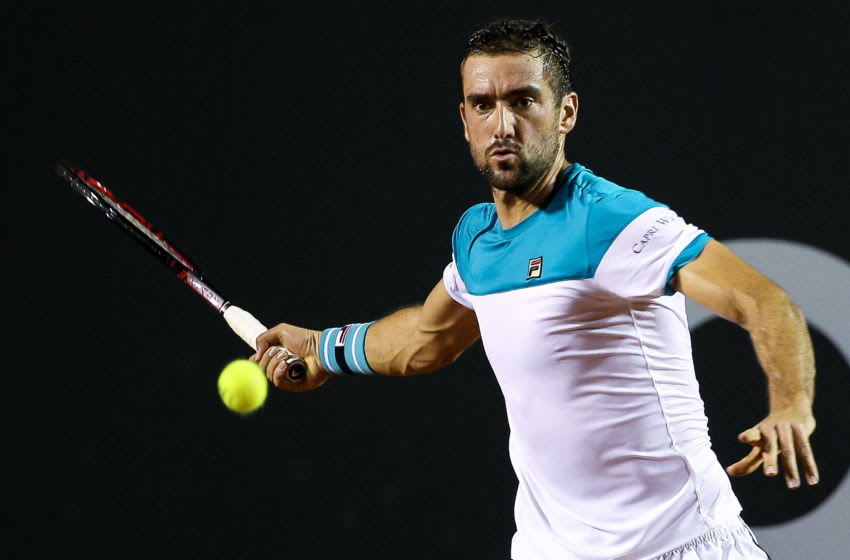RIO DE JANEIRO, BRAZIL - FEBRUARY 19: Marin Cilic of Croatia returns a shot to Carlos Berlocq of Argentina during the ATP Rio Open 2018 at Jockey Club Brasileiro on February 19, 2018 in Rio de Janeiro, Brazil. (Photo by Buda Mendes/Getty Images)