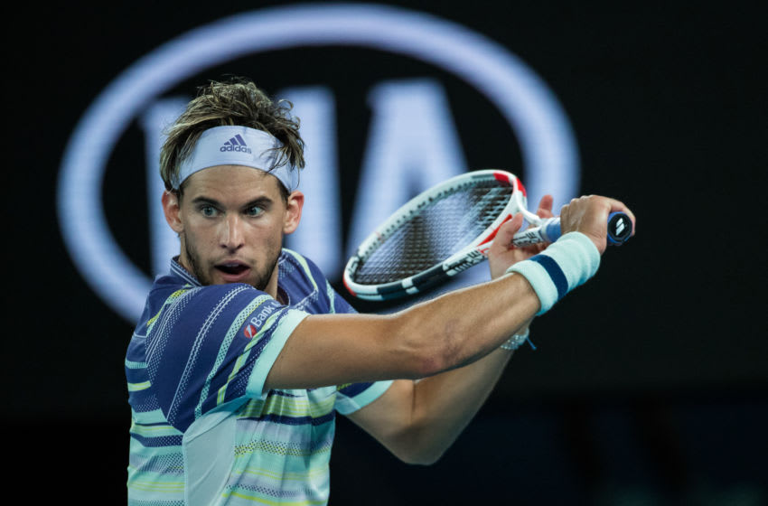 MELBOURNE, AUSTRALIA - FEBRUARY 02: Dominic Thiem of Austria plays a backhand in his men's singles final match against Novak Djokovic of Serbia on day fourteen of the 2020 Australian Open at Melbourne Park on February 02, 2020 in Melbourne, Australia. (Photo by Chaz Niell/Getty Images)