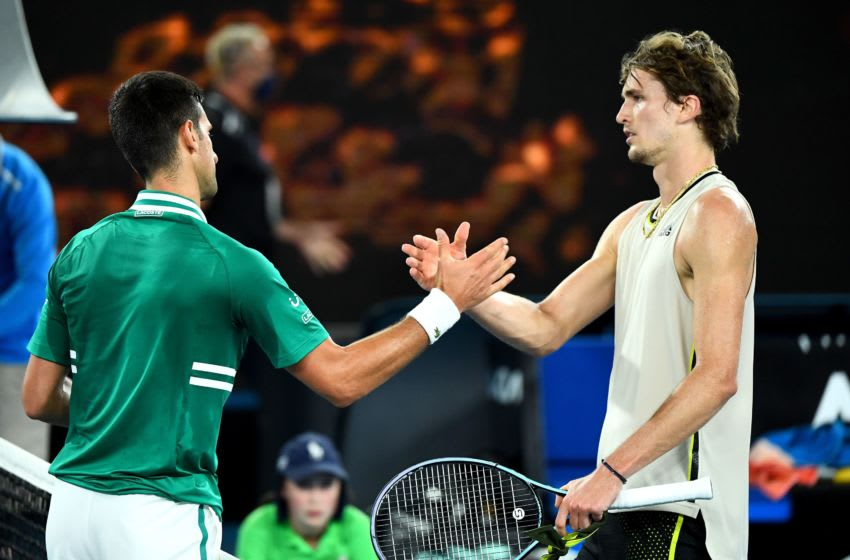 Serbia's Novak Djokovic (L) shakes hands with Germany's Alexander Zverev after their men's singles quarter-final match on day nine of the Australian Open tennis tournament in Melbourne on February 16, 2021. (Photo by William WEST / AFP) / -- IMAGE RESTRICTED TO EDITORIAL USE - STRICTLY NO COMMERCIAL USE -- (Photo by WILLIAM WEST/AFP via Getty Images)
