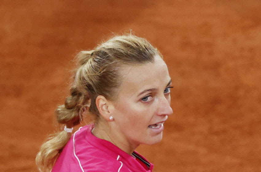 PARIS, FRANCE - OCTOBER 05: Petra Kvitova of Czech Republic celebrates after winning match point during her Women's Singles fourth round match against Shuai Zhang of China on day nine of the 2020 French Open at Roland Garros on October 05, 2020 in Paris, France. (Photo by Clive Brunskill/Getty Images)