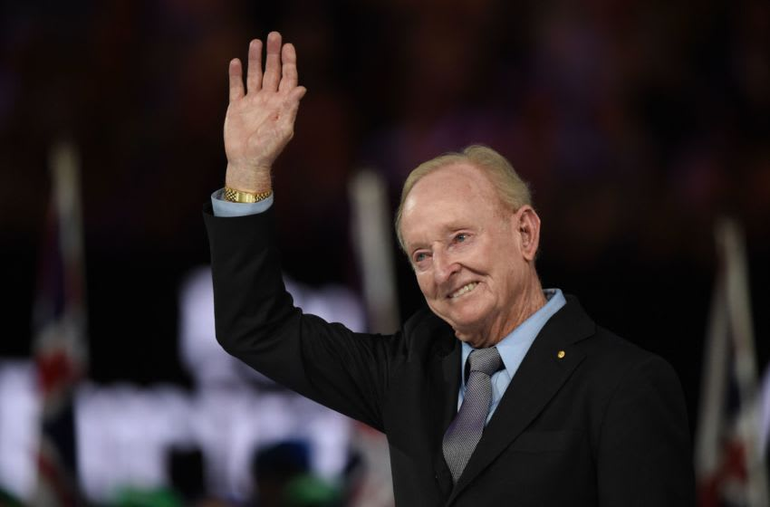 Australian tenis legend Rod Laver waves during the awards ceremony after the men's singles final match between Switzerland's Roger Federer and Spain's Rafael Nadal on day 14 of the Australian Open tennis tournament in Melbourne on January 29, 2017. (Photo by PAUL CROCK / AFP) / IMAGE RESTRICTED TO EDITORIAL USE - STRICTLY NO COMMERCIAL USE (Photo by PAUL CROCK/AFP via Getty Images)