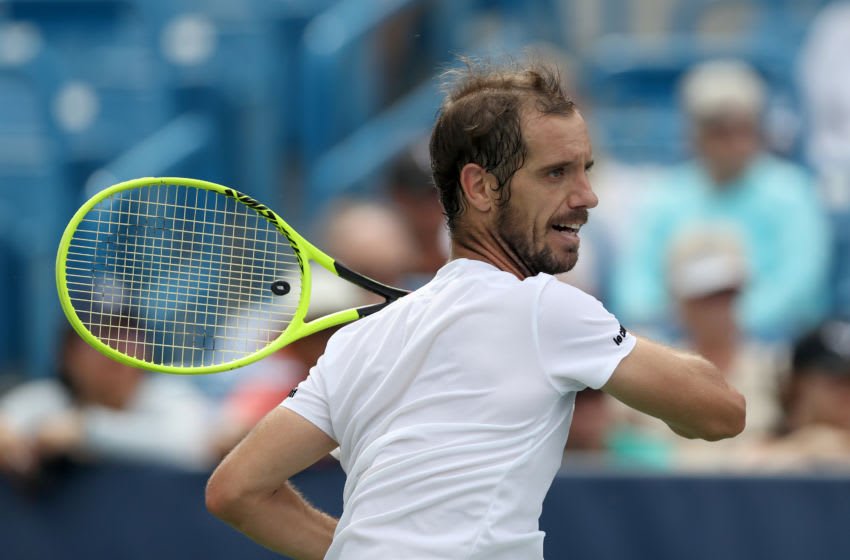 MASON, OHIO - AUGUST 12: Richard Gasquet of France returns a shot to Andy Murray of Great Britain during Day 3 of the Western and Southern Open at Lindner Family Tennis Center on August 12, 2019 in Mason, Ohio. (Photo by Rob Carr/Getty Images)