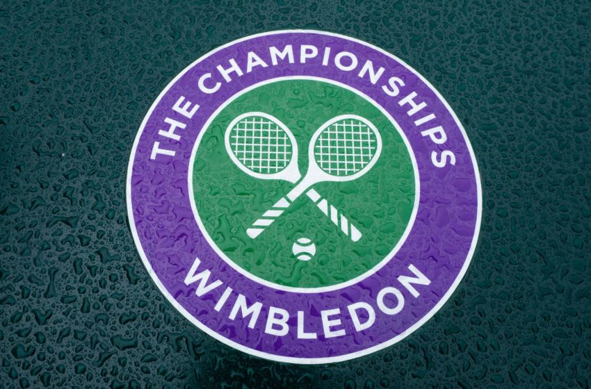 June 27, 2020; London, England, UNITED KINGDOM; Detail of a wet Wimbledon logo at the All England Lawn Tennis Club on a stormy Saturday 27th June 2020 the weekend before The Championships were due to start on Monday 29th June 2020. The grounds are quiet and still, normally they would be busy and bustling with players practicing and groundsmen and staff making the final detailed preparations. The Wimbledon Championships have been cancelled due to the Coronavirus pandemic. Mandatory Credit: AELTC/Bob Martin via USA TODAY Sports