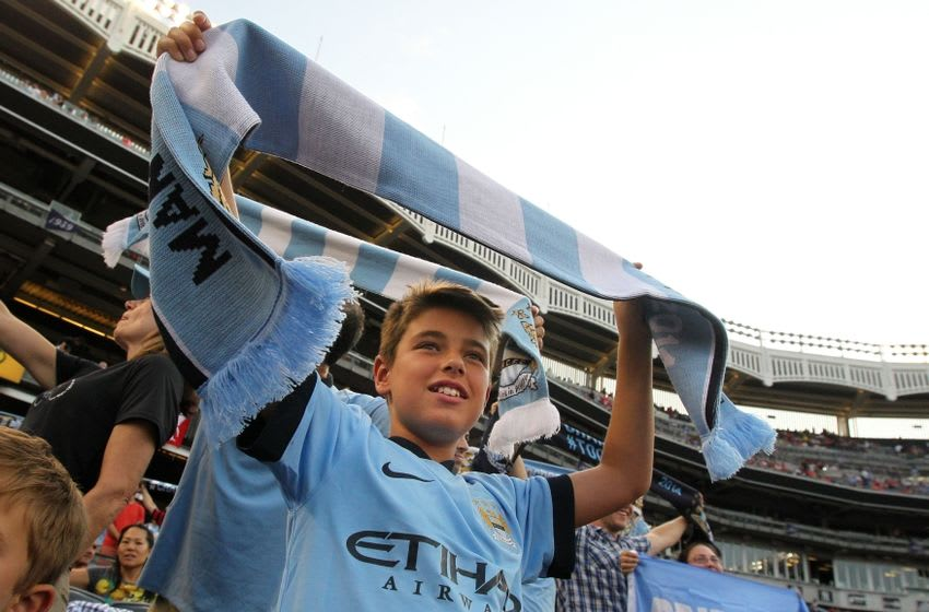 Jul 30, 2014; Bronx, NY, USA; Manchester City FC fans cheer before a game between Liverpool FC and Manchester City FC at Yankee Stadium. Mandatory Credit: Brad Penner-USA TODAY Sports