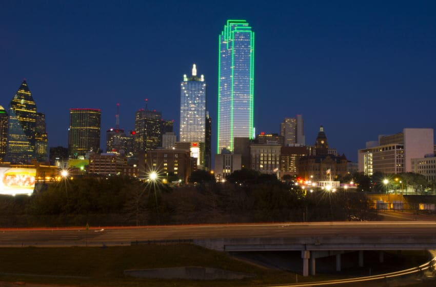 Dallas Texas skyline at sunset twilight night exposure of modern skyscrapers in downtown Dallas city across expressway. (Photo By: Education Images/UIG via Getty Images)