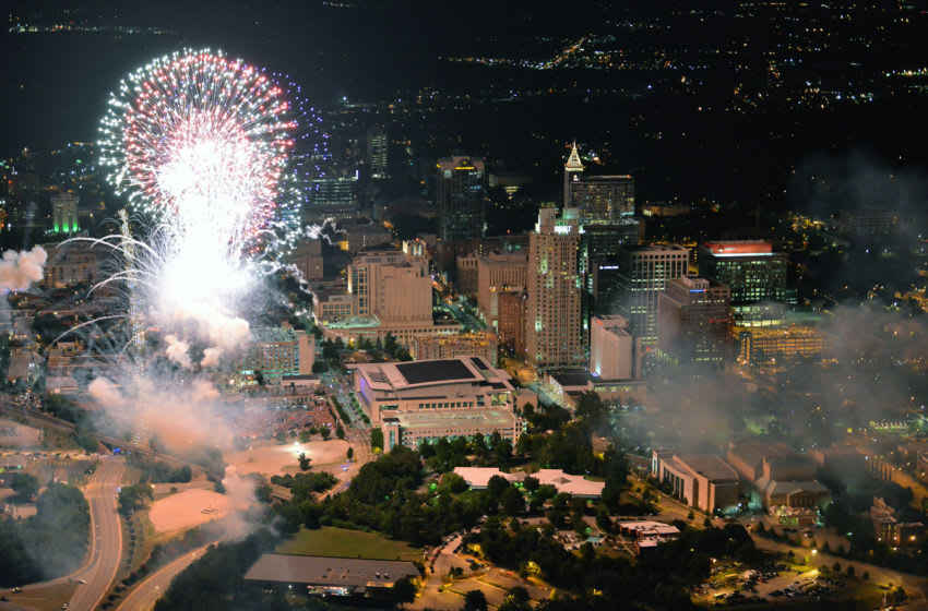 RALEIGH, NC - JULY 4: An aerial view of downtown Raleigh as fireworks light up the sky on July 4, 2014 in Raleigh, North Carolina. The United States marks 238 years as an independent nation as it celebrates the national holiday. (Photo by Lance King/Getty Images)