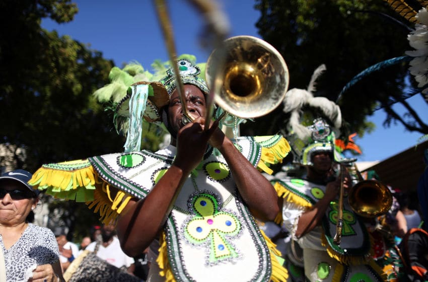 MIAMI, FL - MARCH 15: Dancers participate in a Junkanoo parade during the Calle Ocho festival in the Little Havana neighborhood on March 15, 2015 in Miami, Florida. The annual festival draws thousands of people along a 20 block area for eating, drinking, people watching and dancing. (Photo by Joe Raedle/Getty Images)