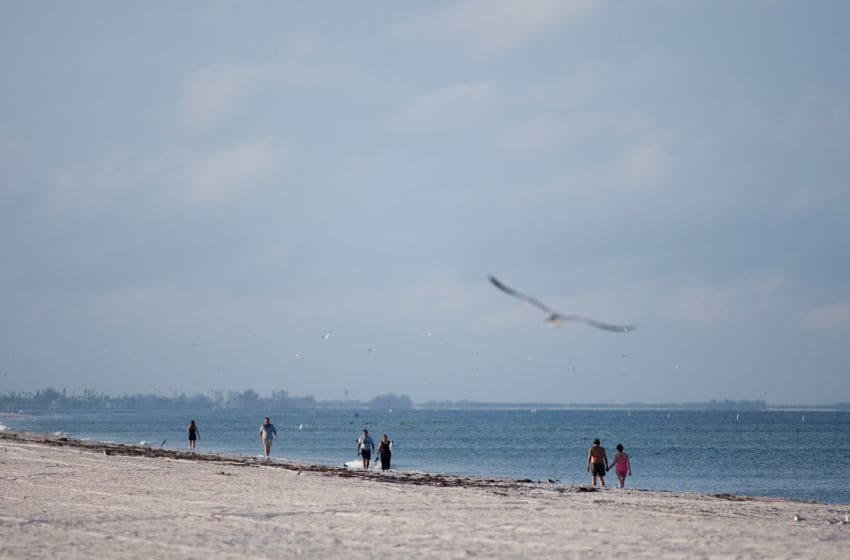 TREASURE ISLAND, FL - AUGUST 26: Beach goers take advantage of a sunny morning ahead of Tropical Storm Isaac on Sunday August 26, 2012 at Treasure Island, Florida. Although Isaac is currently a tropical storm, it is expected to grow to hurricane strength by the time it reaches the Tampa Bay area. (Photo by Edward Linsmier/Getty Images)