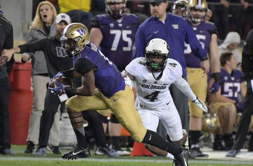 Washington Huskies wide receiver John Ross (1) runs for a touchdown after a catch defended by Colorado Buffaloes defensive back Chidobe Awuzie (4) in the third quarter during the Pac-12 championship at Levi