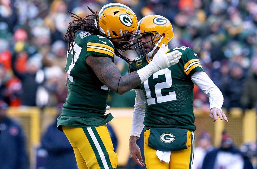 Billy Turner, Aaron Rodgers (Photo by Dylan Buell/Getty Images)