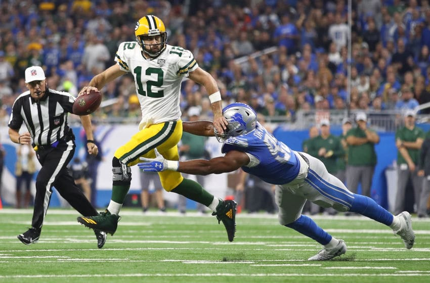 DETROIT, MI - OCTOBER 07: Quarterback Aaron Rodgers #12 of the Green Bay Packers tries to escape the tackle of Romeo Okwara #95 during the first half at Ford Field on October 7, 2018 in Detroit, Michigan. (Photo by Gregory Shamus/Getty Images)