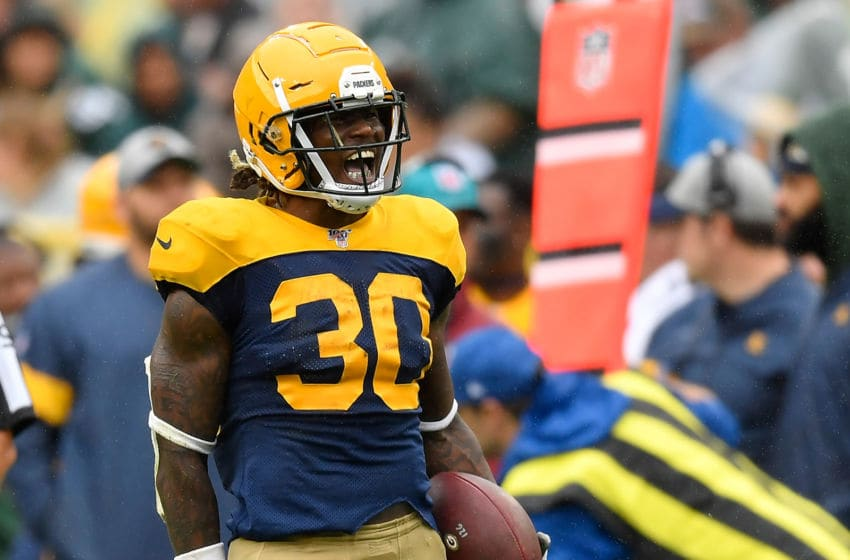 GREEN BAY, WISCONSIN - SEPTEMBER 22: Jamaal Williams #30 of the Green Bay Packers reacts after running for a first down in the fourth quarter against the Denver Broncos at Lambeau Field on September 22, 2019 in Green Bay, Wisconsin. (Photo by Quinn Harris/Getty Images)