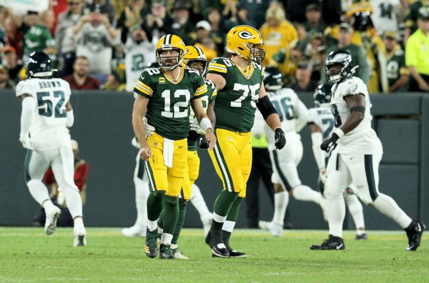 GREEN BAY, WISCONSIN - SEPTEMBER 26: Aaron Rodgers #12 of the Green Bay Packers reacts after fumbling the ball in the second quarter against the Philadelphia Eagles at Lambeau Field on September 26, 2019 in Green Bay, Wisconsin. (Photo by Dylan Buell/Getty Images)