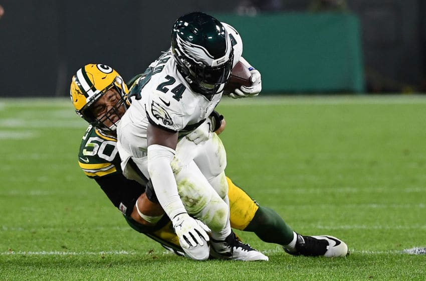 GREEN BAY, WISCONSIN - SEPTEMBER 26: Jordan Howard #24 of the Philadelphia Eagles is brought down by Blake Martinez #50 of the Green Bay Packers during the third quarter at Lambeau Field on September 26, 2019 in Green Bay, Wisconsin. (Photo by Stacy Revere/Getty Images)