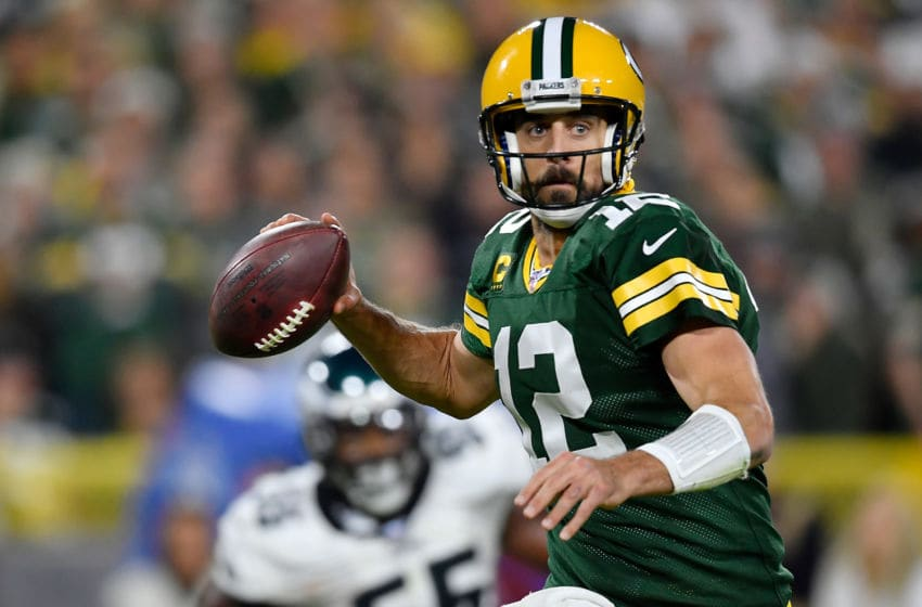 GREEN BAY, WISCONSIN - SEPTEMBER 26: Aaron Rodgers #12 of the Green Bay Packers looks to pass the football in the fourth quarter against the Philadelphia Eagles at Lambeau Field on September 26, 2019 in Green Bay, Wisconsin. (Photo by Quinn Harris/Getty Images)