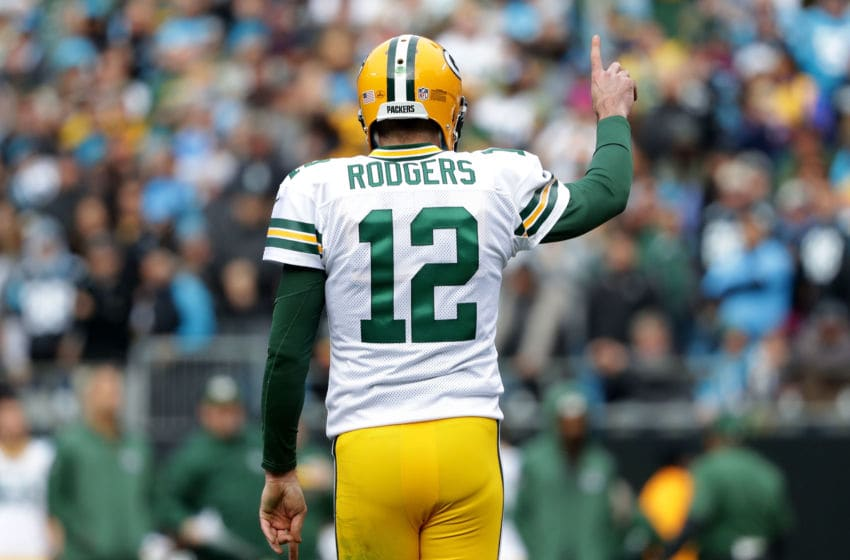 CHARLOTTE, NC - DECEMBER 17: Aaron Rodgers #12 of the Green Bay Packers reacts after throwing a touchdown pass against the Carolina Panthers in the first quarter during their game at Bank of America Stadium on December 17, 2017 in Charlotte, North Carolina. (Photo by Streeter Lecka/Getty Images)