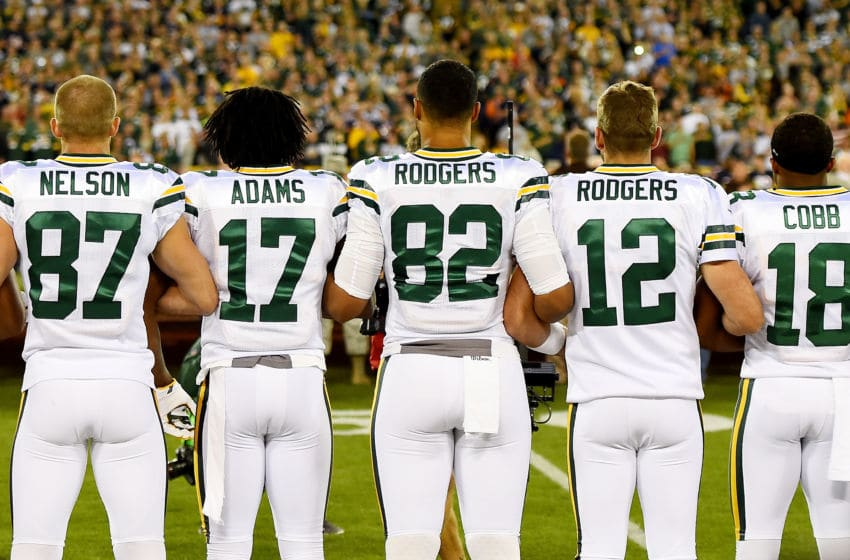 GREEN BAY, WI - SEPTEMBER 28: Green Bay Packers players link arms during the singing of the national anthem before the game against the Chicago Bears at Lambeau Field on September 28, 2017 in Green Bay, Wisconsin. (Photo by Stacy Revere/Getty Images)