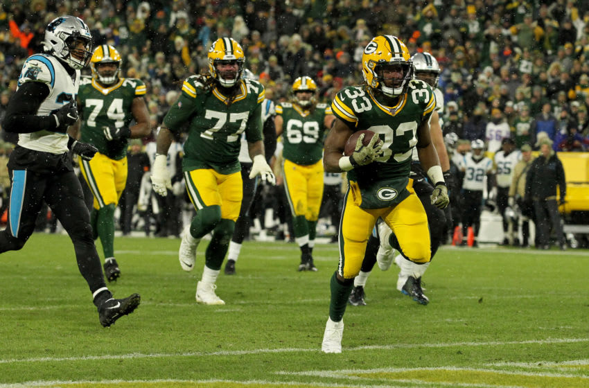 GREEN BAY, WISCONSIN - NOVEMBER 10: Aaron Jones #33 of the Green Bay Packers scores a touchdown against the Carolina Panthers in the game at Lambeau Field on November 10, 2019 in Green Bay, Wisconsin. (Photo by Dylan Buell/Getty Images)