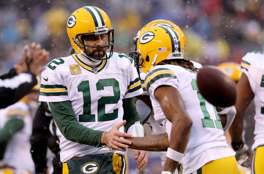 Green Bay Packers, Aaron Rodgers, Davante Adams (Photo by Elsa/Getty Images)