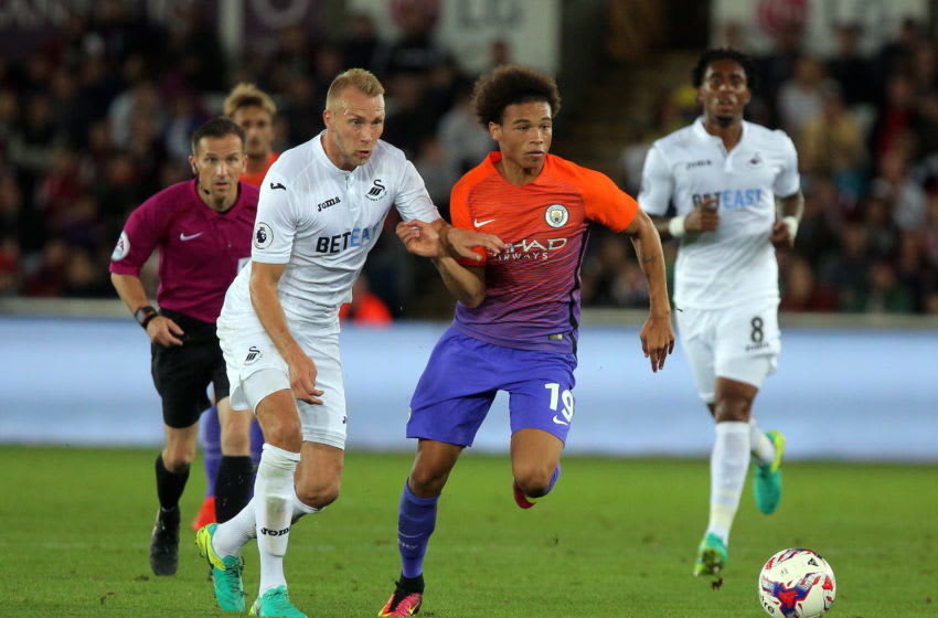 SWANSEA, WALES - SEPTEMBER 21: (L-R) Mike van der Hoorn of Swansea City challenges Leroy Sane of Manchester City during the EFL Cup Third Round match between Swansea City and Manchester City at The Liberty Stadium on September 21, 2016 in Swansea, Wales. (Photo by Athena Pictures/Getty Images)
