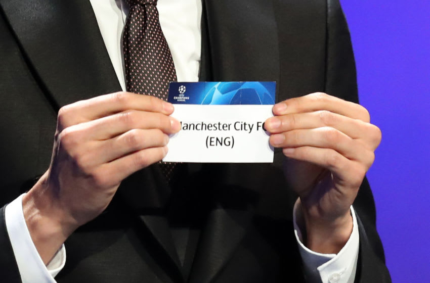 Brazilian former football player Kaka shows the name of Manchester City during the draw for UEFA Champions League football tournament at The Grimaldi Forum in Monaco on August 30, 2018. (Photo by Valery HACHE / AFP) (Photo credit should read VALERY HACHE/AFP via Getty Images)