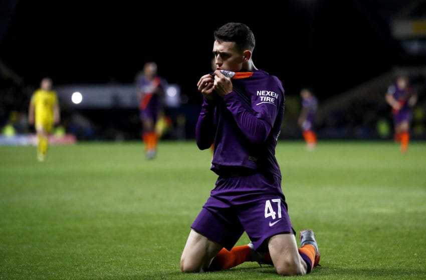 OXFORD, ENGLAND - SEPTEMBER 25: Phil Foden of Manchester City celebrates after scoring his team's third goal during the Carabao Cup Third Round match between Oxford United and Manchester City at Kassam Stadium on September 25, 2018 in Oxford, England. (Photo by Julian Finney/Getty Images)