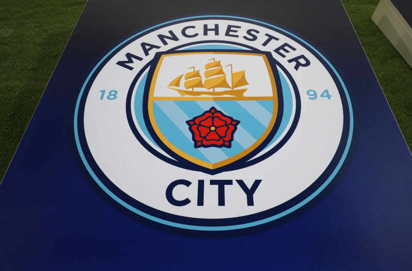 MANCHESTER, ENGLAND - NOVEMBER 07: The Manchester City badge on a board during the Group F match of the UEFA Champions League between Manchester City and FC Shakhtar Donetsk at Etihad Stadium on November 7, 2018 in Manchester, United Kingdom. (Photo by James Williamson - AMA/Getty Images)