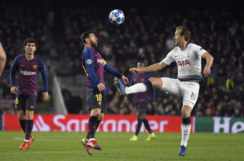 BARCELONA, SPAIN - DECEMBER 11: Lionel Messi of FC Barcelona and Harry Kane of Tottenham Hotspur battle for the ball during the UEFA Champions League Group B match between FC Barcelona and Tottenham Hotspur at Camp Nou on December 11, 2018 in Barcelona, Spain. (Photo by TF-Images/TF-Images via Getty Images)