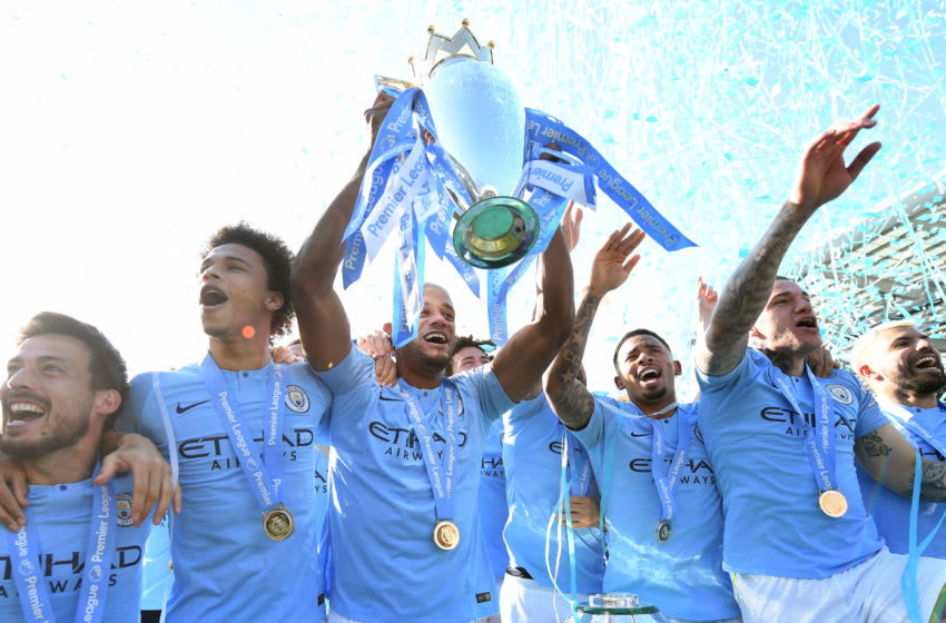 BRIGHTON, ENGLAND - MAY 12: Vincent Kompany of Manchester City lifts the Premier League Trophy after winning the title during the Premier League match between Brighton & Hove Albion and Manchester City at American Express Community Stadium on May 12, 2019 in Brighton, United Kingdom. (Photo by Michael Regan/Getty Images)