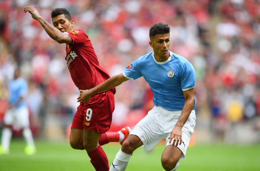 LONDON, ENGLAND - AUGUST 04: Rodri of Manchester City battles for possession with Roberto Firmino of Liverpool during the FA Community Shield match between Liverpool and Manchester City at Wembley Stadium on August 04, 2019 in London, England. (Photo by Clive Mason/Getty Images)
