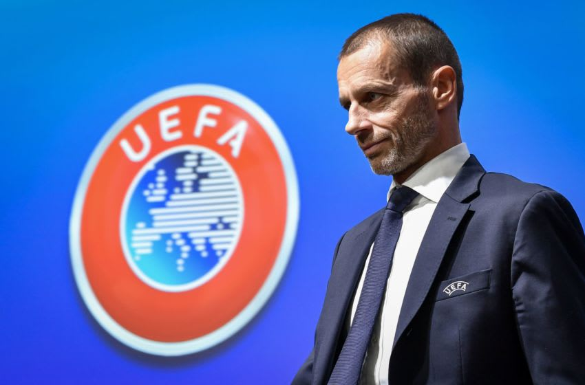 UEFA president Aleksander Ceferin walks past a sign with the UEFA logo after attending a press conference following a meeting of the executive committee at the UEFA headquarters, in Nyon, Switzerland on December 4, 2019. (Photo by Fabrice COFFRINI / AFP) (Photo by FABRICE COFFRINI/AFP via Getty Images)