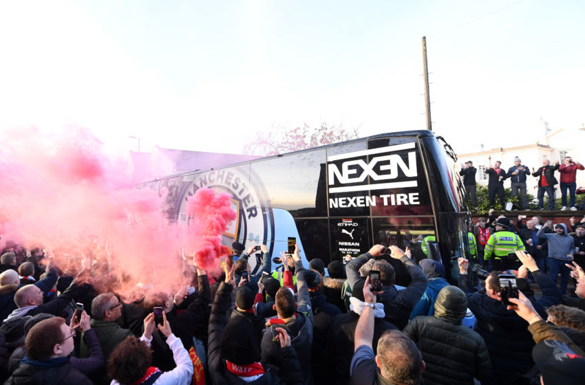 LIVERPOOL, ENGLAND - NOVEMBER 10: Liverpool fans let off smoke flares as the Manchester City team coach arrives at the stadium prior to the Premier League match between Liverpool FC and Manchester City at Anfield on November 10, 2019 in Liverpool, United Kingdom. (Photo by Laurence Griffiths/Getty Images)
