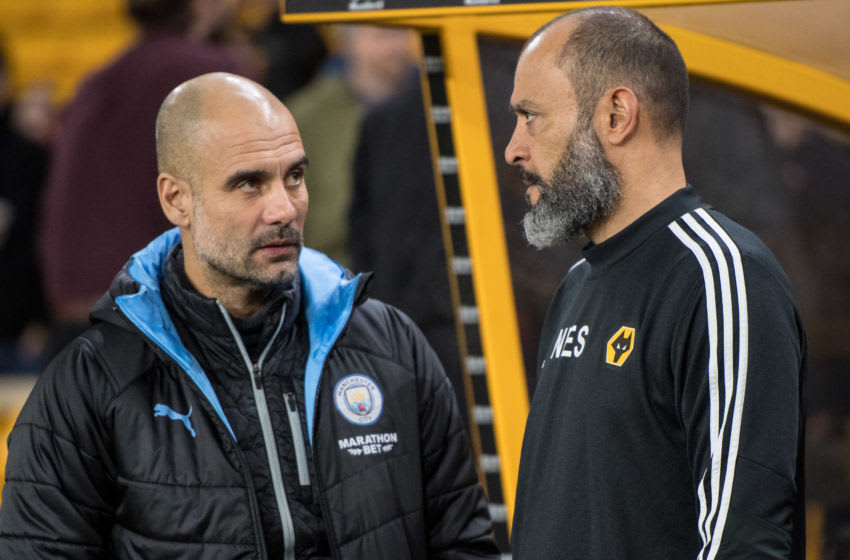 WOLVERHAMPTON, ENGLAND - DECEMBER 27: manager Pep Guardiola of Manchester City and manager Nuno Espirito Santo of Wolverhampton Wanderers during the Premier League match between Wolverhampton Wanderers and Manchester City at Molineux on December 27, 2019 in Wolverhampton, United Kingdom. (Photo by Sebastian Frej/MB Media/Getty Images)