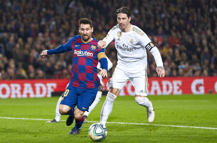 BARCELONA, SPAIN - DECEMBER 18: Lionel Messi of FC Barcelona competes for the ball with Sergio Ramos of Real Madrid during the Liga match between FC Barcelona and Real Madrid CF at Camp Nou on December 18, 2019 in Barcelona, Spain. (Photo by Quality Sport Images/Getty Images)