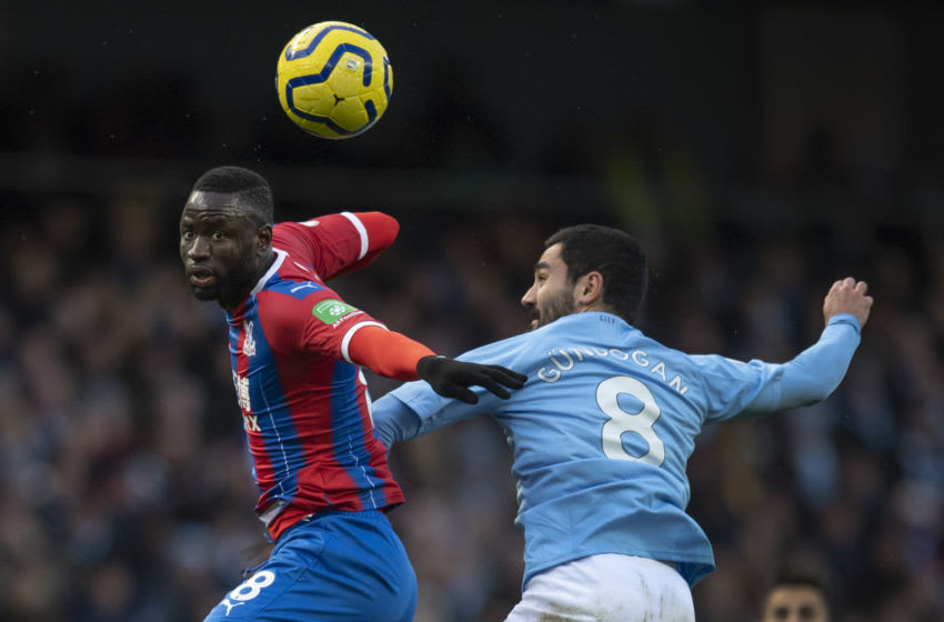 MANCHESTER, ENGLAND - JANUARY 18: Cheikhou Kouyate of Crystal Palace and Bernardo Silva of Manchester City in action during the Premier League match between Manchester City and Crystal Palace at Etihad Stadium on January 18, 2020 in Manchester, United Kingdom. (Photo by Visionhaus)