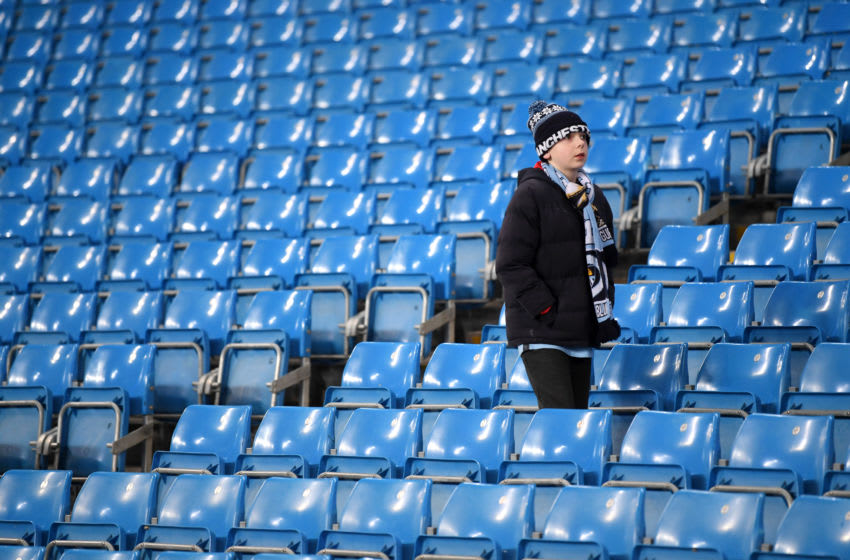 MANCHESTER, ENGLAND - JANUARY 29: A young Manchester City fan arrives inside the stadium prior to the Carabao Cup Semi Final match between Manchester City and Manchester United at Etihad Stadium on January 29, 2020 in Manchester, England. (Photo by Laurence Griffiths/Getty Images)