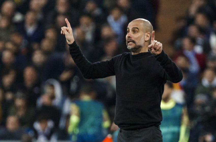 MADRID, SPAIN - FEBRUARY 26: (BILD ZEITUNG OUT) head coach Pep Guardiola of Manchester City gestures during the UEFA Champions League round of 16 first leg match between Real Madrid and Manchester City at Bernabeu on February 26, 2020 in Madrid, Spain. (Photo by DeFodi Images via Getty Images)