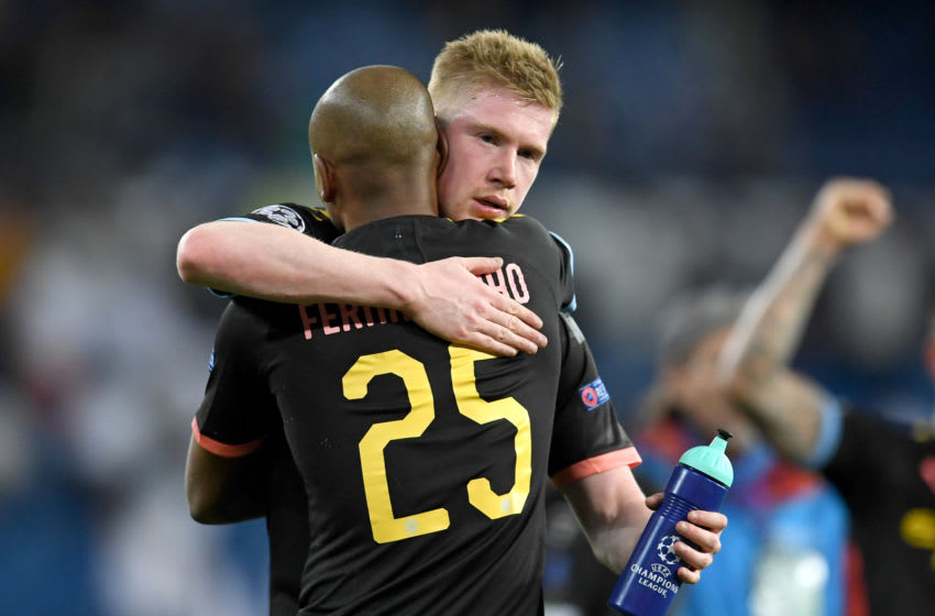 MADRID, SPAIN - FEBRUARY 26: Kevin De Bruyne of Manchester City and Fernandinho of Manchester City celebrate following their sides victory in the UEFA Champions League round of 16 first leg match between Real Madrid and Manchester City at Bernabeu on February 26, 2020 in Madrid, Spain. (Photo by David Ramos/Getty Images)