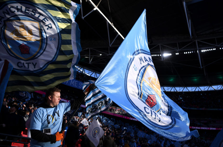 LONDON, ENGLAND - MARCH 01: Fans wave flags prior to the Carabao Cup Final between Aston Villa and Manchester City at Wembley Stadium on March 01, 2020 in London, England. (Photo by Laurence Griffiths/Getty Images)