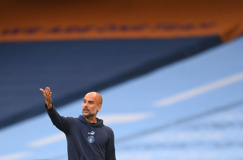 Manchester City's Spanish manager Pep Guardiola gestures during the English Premier League football match between Manchester City and Burnley at the Etihad Stadium in Manchester, north west England, on June 22, 2020. (Photo by Michael Regan / POOL / AFP) / RESTRICTED TO EDITORIAL USE. No use with unauthorized audio, video, data, fixture lists, club/league logos or 'live' services. Online in-match use limited to 120 images. An additional 40 images may be used in extra time. No video emulation. Social media in-match use limited to 120 images. An additional 40 images may be used in extra time. No use in betting publications, games or single club/league/player publications. / (Photo by MICHAEL REGAN/POOL/AFP via Getty Images)