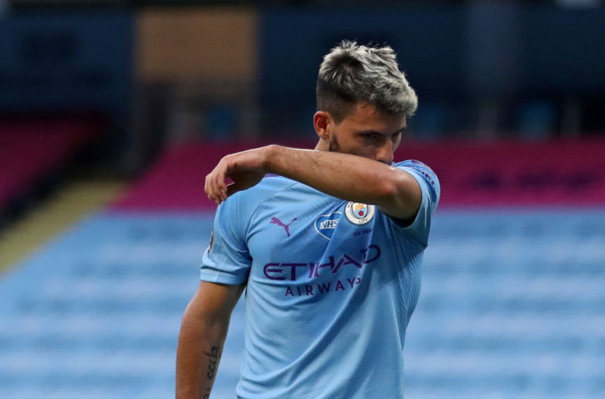 Manchester City's Argentinian striker Sergio Aguero reacts as he leaves the pitch, injured in a challenge with Burnley's English defender Ben Mee (not pictured) during the English Premier League football match between Manchester City and Burnley at the Etihad Stadium in Manchester, north west England, on June 22, 2020. (Photo by Martin Rickett / POOL / AFP) / RESTRICTED TO EDITORIAL USE. No use with unauthorized audio, video, data, fixture lists, club/league logos or 'live' services. Online in-match use limited to 120 images. An additional 40 images may be used in extra time. No video emulation. Social media in-match use limited to 120 images. An additional 40 images may be used in extra time. No use in betting publications, games or single club/league/player publications. / (Photo by MARTIN RICKETT/POOL/AFP via Getty Images)