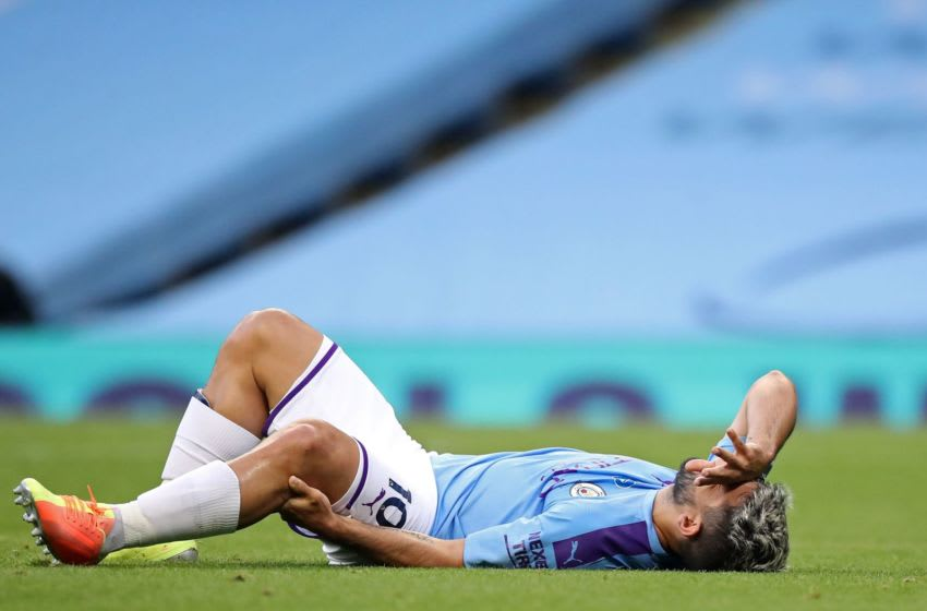 Manchester City's Argentinian striker Sergio Aguero reacts after being injured in a challenge with Burnley's English defender Ben Mee (not pictured) during the English Premier League football match between Manchester City and Burnley at the Etihad Stadium in Manchester, north west England, on June 22, 2020. (Photo by Martin Rickett / POOL / AFP) / RESTRICTED TO EDITORIAL USE. No use with unauthorized audio, video, data, fixture lists, club/league logos or 'live' services. Online in-match use limited to 120 images. An additional 40 images may be used in extra time. No video emulation. Social media in-match use limited to 120 images. An additional 40 images may be used in extra time. No use in betting publications, games or single club/league/player publications. / (Photo by MARTIN RICKETT/POOL/AFP via Getty Images)