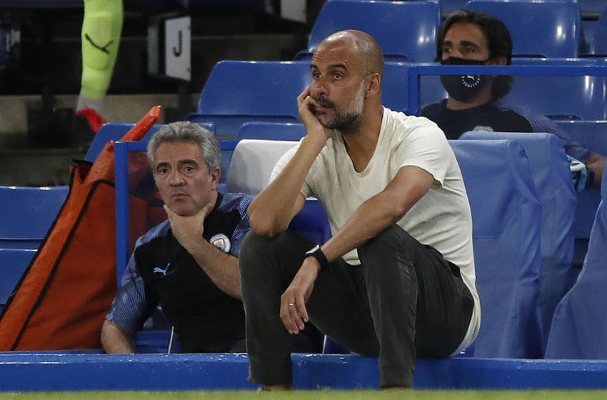 Manchester City's Spanish manager Pep Guardiola reacts during the English Premier League football match between Chelsea and Manchester City at Stamford Bridge in London on June 25, 2020. - Cheslea won the match 2-1. Jurgen Klopp's legendary status at Anfield was secured on Thursday as he became the first Liverpool manager to win a league title in 30 years. (Photo by PAUL CHILDS / POOL / AFP) / RESTRICTED TO EDITORIAL USE. No use with unauthorized audio, video, data, fixture lists, club/league logos or 'live' services. Online in-match use limited to 120 images. An additional 40 images may be used in extra time. No video emulation. Social media in-match use limited to 120 images. An additional 40 images may be used in extra time. No use in betting publications, games or single club/league/player publications. / (Photo by PAUL CHILDS/POOL/AFP via Getty Images)