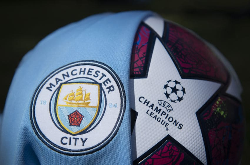 MANCHESTER, ENGLAND - MAY 05: The Manchester City club crest on the first team home shirt displayed with a UEFA Champions League match ball on May 5, 2020 in Manchester, England (Photo by Visionhaus)