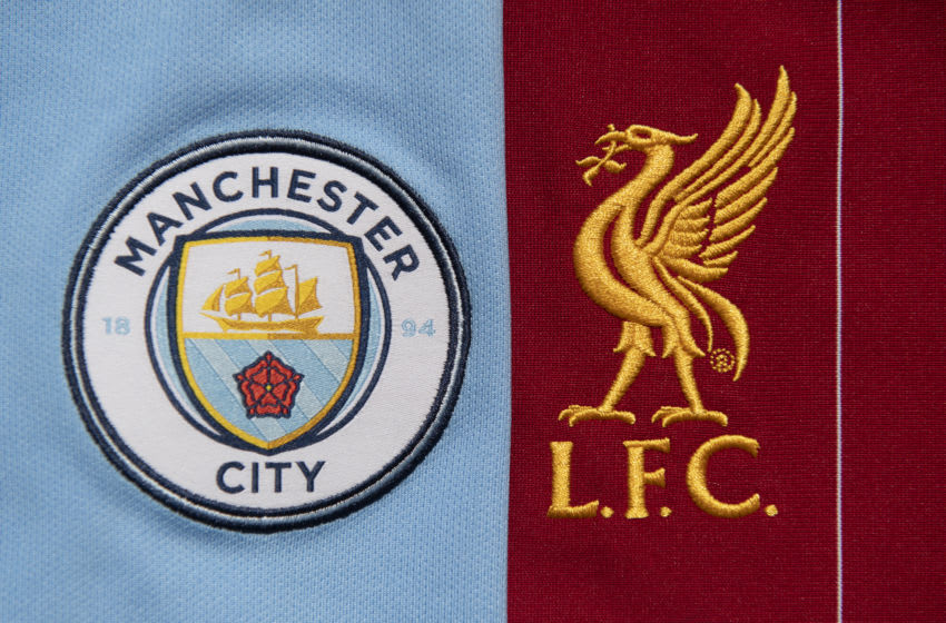 MANCHESTER, ENGLAND - MAY 04: The Liverpool and Manchester City club crests on their first team home shirts on May 4, 2020 in Manchester, England (Photo by Visionhaus)
